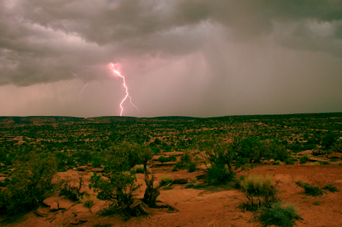 Lightning splits the sky over the mesas outside Moab, UT.